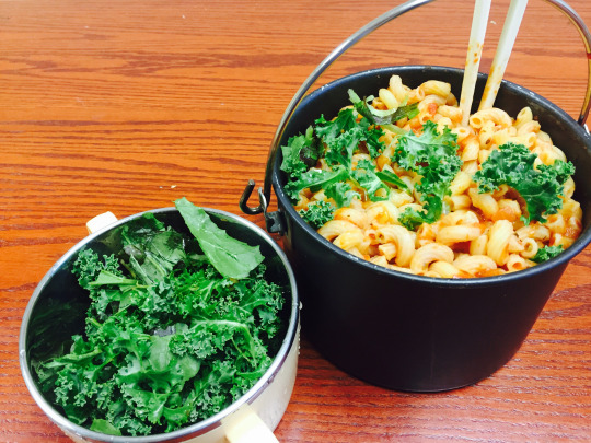 Kristen Lee snipped fresh kale from the Davis Library edible garden to jazz up her macaroni and cheese.